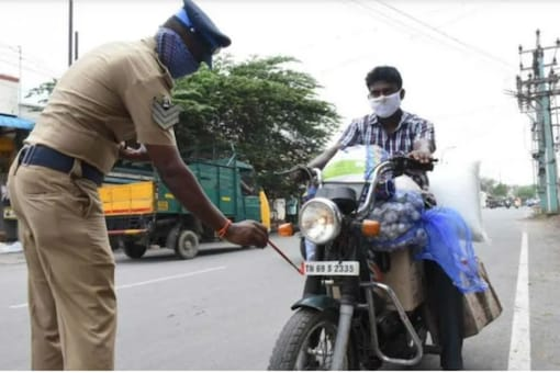 For representation only: Tamil Nadu Police paints the number plate of a two-wheeler.