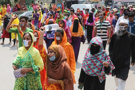 Garment workers walk on the street demanding their due wages during the lockdown amid concerns over the coronavirus disease (COVID-19) outbreak in Dhaka, Bangladesh, April 13, 2020. (Image: REUTERS)