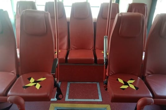 SpiceJet shuttle buses with crosses on seats.