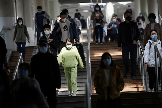 People wearing face masks walk inside a subway train during morning rush hour in Beijing, as the spread of the novel coronavirus disease (COVID-19) continues in  China. (Reuters)