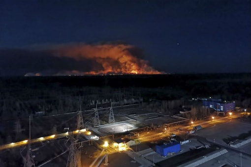 A forest fire is seen burning near Ukraine's Chernobyl nuclear power plant Friday April 10, 2020. (Image: AP)