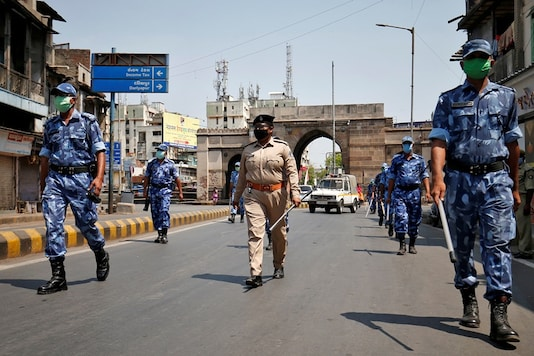 Members of Rapid Action Force (RAF) patrol an empty street after India extended a nationwide lockdown to slow the spreading of coronavirus disease (COVID-19), in Ahmedabad. (Image: REUTERS)