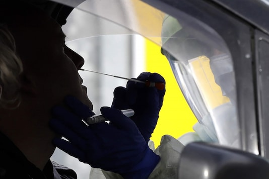 Medical staff test a shopper in his car who volunteered at a pop-up community COVID-19 testing station at a supermarket carpark in Christchurch, New Zealand. (Image: AP)