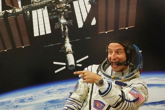 FILE PHOTO: International Space Station (ISS) crew member Andrew Morgan of NASA reacts during a spacesuit check at the Baikonur Cosmodrome, Kazakhstan, July 20, 2019. REUTERS/Maxim Shemetov/File Photo