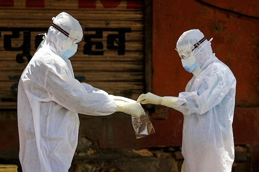 Medics during a door-to-door examination of COVID-19 at Walled City in Jaipur. (PTI)