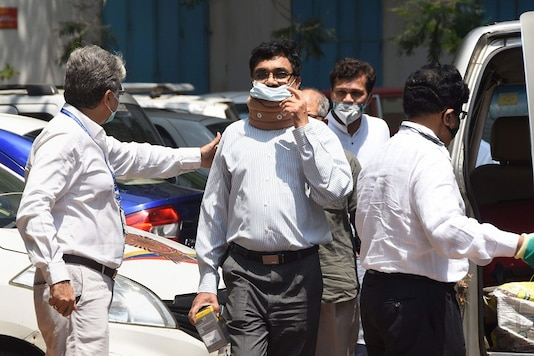 File photo: Activist and scholar Anand Teltumbde arrives to surrender before the NIA  in connection with the Elgar Parishad-Maoist links case, in Mumbai. (PTI Photo)