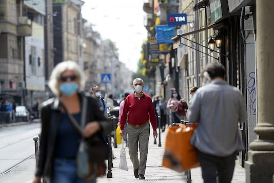 For representation: People wearing protective masks walk in an increasingly busy street, amid the coronavirus disease (COVID-19) outbreak, in Milan, Italy. (Reuters)