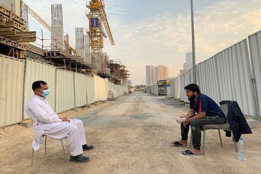 Two guards working at a construction site keep distance during a lockdown in Dubai, United Arab Emirates. (Reuters)