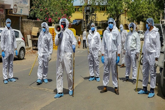 For representation: Police personnel wearing protective suits patrol a street during a nationwide lockdown to slow the spreading of coronavirus, in Ahmedabad, Gujarat. (PTI)