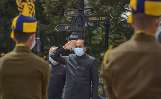 Himachal Pradesh Chief Minister Jai Ram Thakur wearing face mask amid COVID-19 outbreak salutes the Tricolor after unfurling it during 73rd Himachal Day parade at Ridge in Shimla. (Image: PTI)