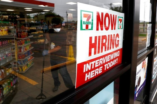 A sign on the window at a 7-Eleven store reads,