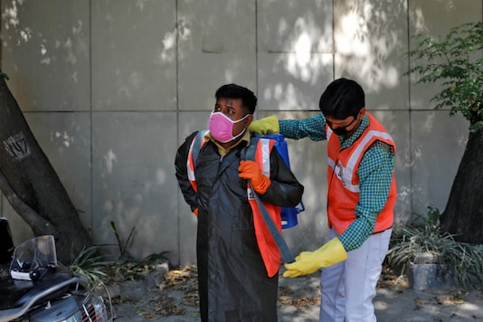 For representationA sanitation worker gets ready for work. (Reuters)