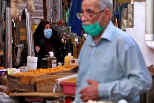 People shop in preparation for the Muslim fasting month of Ramadan, in Baghdad, Iraq. (Image: AP)