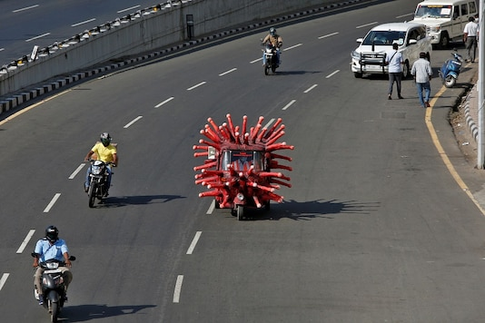 A man drives an auto-rickshaw depicting the coronavirus to create awareness about staying at home during a nationwide lockdown in Chennai. (Reuters)