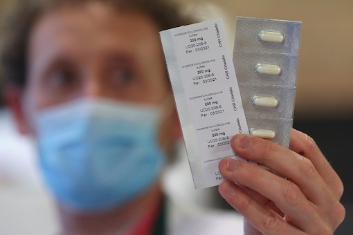 A pharmacy worker shows pills of hydroxychloroquine used to treat the coronavirus disease at the CHR Centre Hospitalier Regional de la Citadelle Hospital in Liege, Belgium. (Reuters)