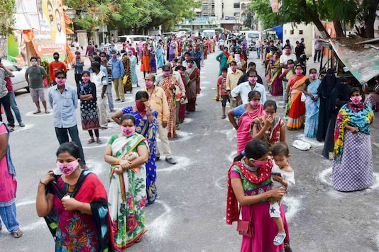 People queue up for relief materials in Hyderabad during lockdown. (PTI)