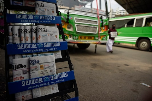 Newspapers are displayed for sale outside a shop at a bus terminus which has been shut down for more than a month as part of measures to curb the spread of the COVID-19 pandemic in Kochi, Kerala. (AP)