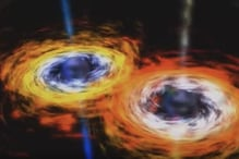 Scientists Have Spotted Two Massive Black Holes Dancing Around Each Other
