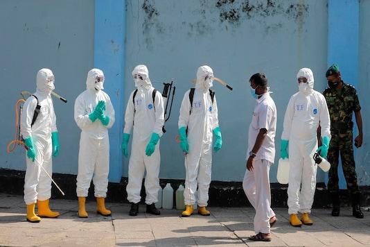 Sri Lankan police commandos prepare to spray disinfectants in a hospital in Colombo, Sri Lanka. (AP Photo)