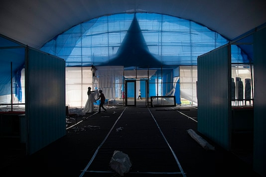 Workers prepare a quarantine center at the Sarusojai sports complex in Gauhati, Assam. (AP)