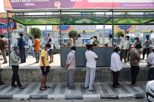 People line up to buy grocery during lockdown as a precautionary measure against COVID-19 in Hyderabad, Telangana. (AP Photo)
