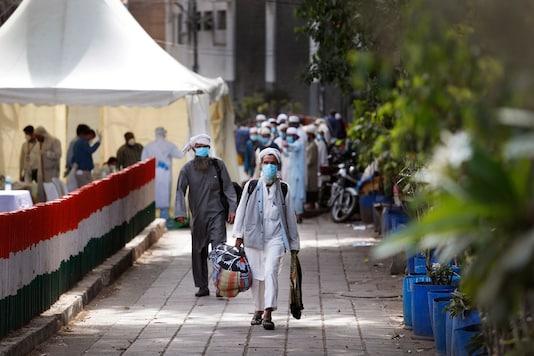 Representative Image.  Pilgrims walk towards a bus bound for a quarantine facility amid concerns over the spread of the new coronavirus, at the Nizamuddin area of New Delhi on March 31, 2020. (AP Photo/Manish Swarup)