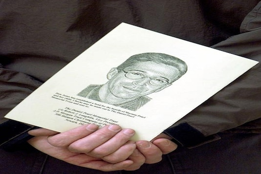 A portrait of the Wall Street Journal's reporter Daniel Pearl is held at a memorial service at Fleet Street's journalists chapel, St Brides Church in London March 5, 2002.