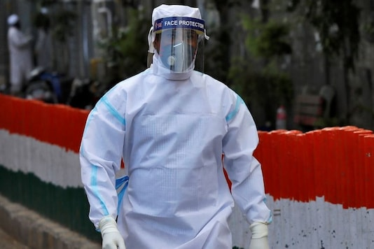 Representative Image. A health worker wearing a protective suit walks after moving people to a quarantine facility, amid concerns about the spread of coronavirus disease (COVID-19), in Nizamuddin area of  New Delhi, India. March 30, 2020. REUTERS/Danish Siddiqui