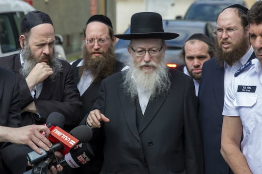 In this Monday, March 2, 2020 photo, Israel's Health Minister Yaakov Litzman delivers a statement as he visits a makeshift tent for quarantined coronavirus voters in Tel Aviv, Israel. (AP)