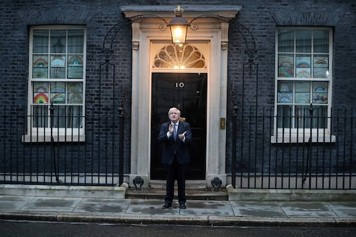 Britain's PM Boris Johnson applauds outside 10 Downing Street during the Clap for our Carers campaign in support of the NHS, following the outbreak of the coronavirus disease in London, Britain, April 30, 2020. (Photo: Reuters/Hannah McKay)