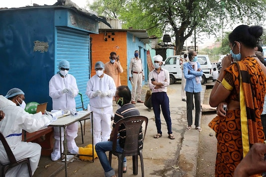 File photo: A team of doctors wearing protective suits examine the residents of Vallabh Nagar locality in wake of the coronavirus pandemic in Bhopal. (PTI)