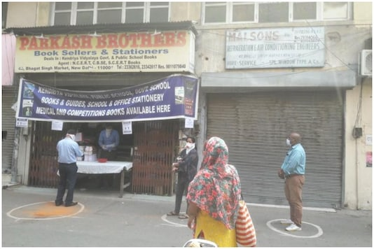 Customers practicing social distancing outside a bookstore that opened on May 4 as government relaxed lockdown restrictions in Delhi | Image credit: Twitter