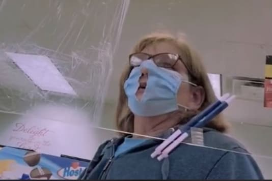 This Covidiot Woman Has Cut a Hole in Her Mask to Help her Breathe
