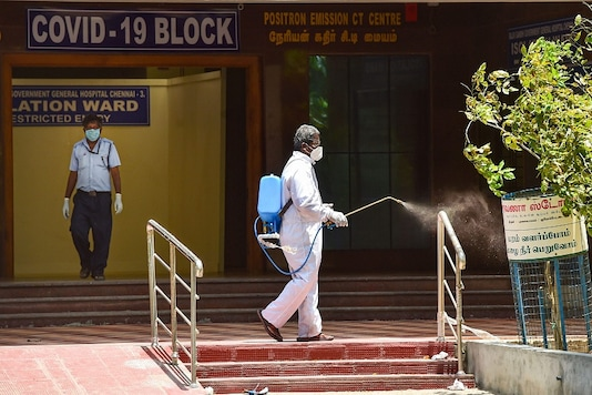 A health worker sprays disinfectant at Rajiv Gandhi Government General Hospital in Chennai. (PTI Photo)