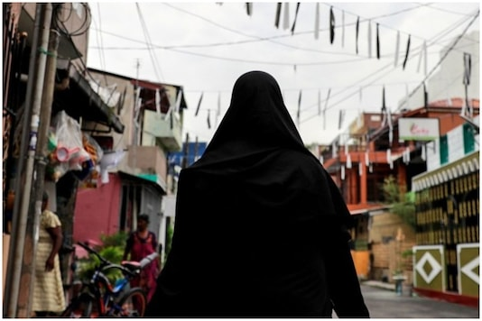 Imrana Saifi, a mother of three, fasts for Ramzaan everyday but does not fail to step out with the sanitiser tank to disinfect local religious places of worship | Image for representation | Credit: Reuters
