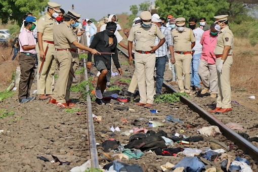 Police officers examine the railway track after a train ran over migrant workers sleeping on the track in Aurangabad in Maharashtra. (Image: Reuters)