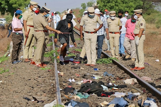 Police officers examine the railway track after a train ran over migrant workers sleeping on the track in Aurangabad in Maharashtra on May 8, 2020. (REUTERS)