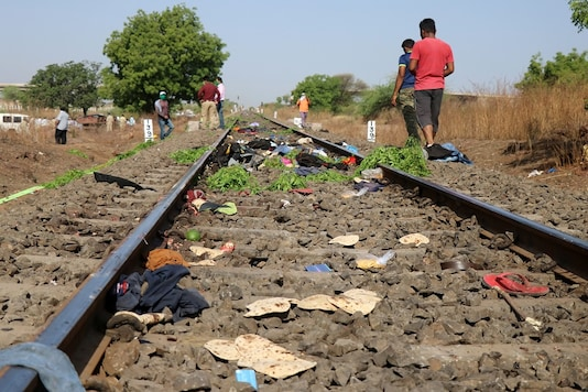 The belongings of victims lie scattered on the railway track after a train ran over migrant workers sleeping on the track in Aurangabad district on Friday. (Reuters)