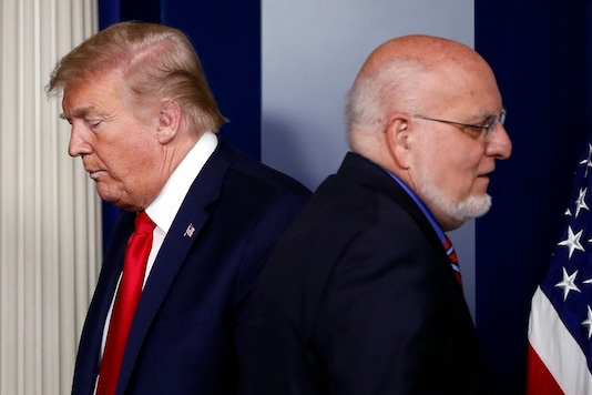 File photo President Donald Trump passes Dr Robert Redfield, director of the Centers for Disease Control and Prevention. (AP)