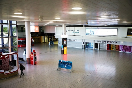 FILE PHOTO:  A man walks into a deserted Gatwick airport, Britain.   REUTERS/Hannah McKay/File photo