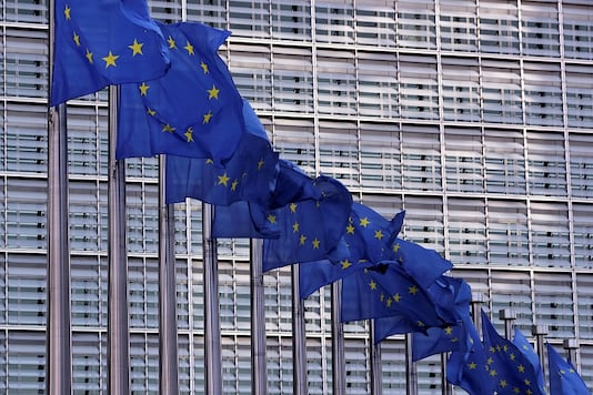 FILE PHOTO: European Union flags fly outside the European Commission headquarters in Brussels, Belgium.  REUTERS/Yves Herman/File Photo