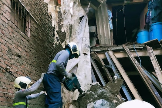 Rescue operations underway after a portion of a chawl collapsed in Mumbai.