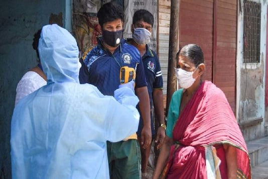 A healthcare worker screens residents in Chennai as the city has become a hotbed of coronavirus with over 3,800 cases. (Photo: PTI)
