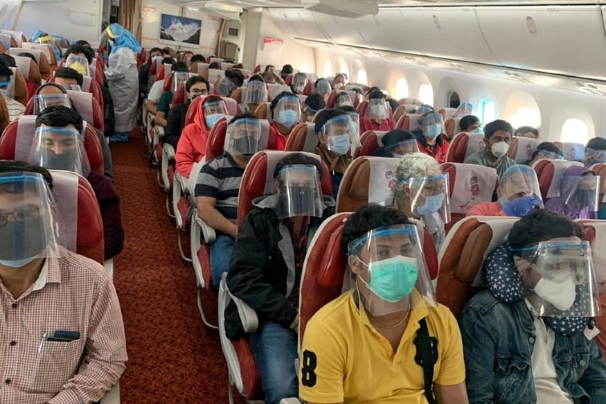 With No COVID-19 Vaccine in Sight, Here's How Air Travel Will ...