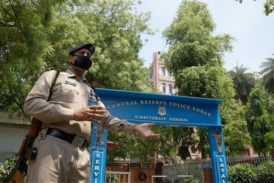 A CRPF jawan stands guard outside the force's headquarters (Photo Credit: PTI)