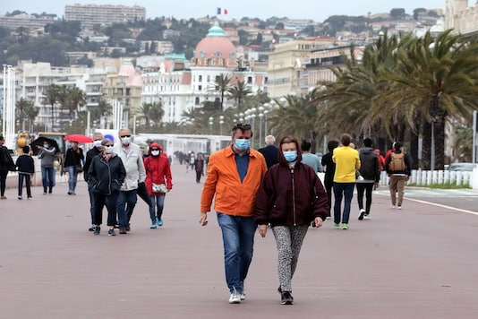 For representation: People wearing protective face masks walk on the Promenade des Anglais in Nice as France softens its strict lockdown rules during the outbreak of the coronavirus disease (COVID-19) in France on Monday. (Reuters)