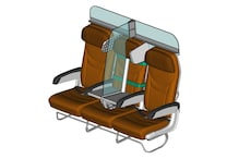 Protective Glass Shield Installed in Middle Seat Could be the Future of Air Travel Post Lockdown