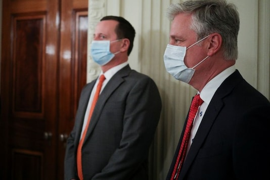 For representation: Acting US Director of National Intelligence Richard Grenell and White House National Security Adviser Robert O'Brien wear protective face masks because of the coronavirus disease (COVID-19) outbreak. (Reuters)