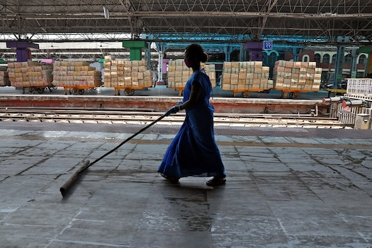 File photo of a worker cleaning a platform at the Howrah Junction railway station. (Reuters)