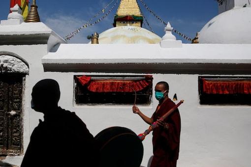 Buddhist monks  during a COVID-19 coronavirus lockdown in Kathmandu, Nepal (Photo Credit: AP)